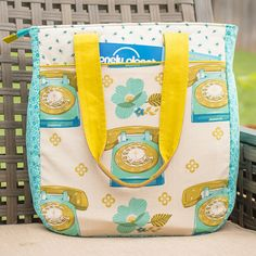 A version of the Noodlehead pattern, Super Tote, using Melody Miller and Denyse Schmidt fabrics, as well as a coordinating camera strap cover.