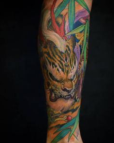 Chronic Ink Tattoo - Toronto Tattoo  Tiger tattoo (done via freehand) on the calf, done by Tristen.