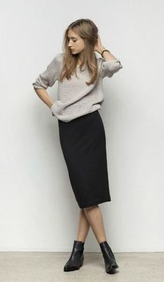 We love this minimalist, simple outfit. Straight, fitted black pencil skirt with a loose but flattering grey sweater. We love this style! You can dress this up or down depending what you're doing that day. /francesca/ #wearingclothesthatflatteryou