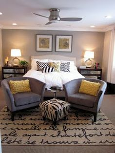 Gray bedroom with yellow, black, and white accents.