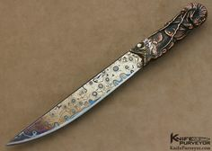 """Hugh Bartrug Custom Knife Sole Authorship """"Frog Skin"""" BLued Nickel Damascus with Lost Wax Cast Phosphorus Copper """"Fish Knife"""". Blade Length: 6 3/4"""" OverallLength: 10 5/8"""" Blade Steel: Sole Authorship """"Frog Skin"""" Nickel Damascus Scale Material: Lost Wax Cast Phosphorus Copper with Pearl & Red Coral Inlays"""