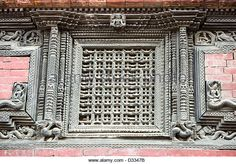 Ancient, ornately carved wood window frames on an old building in Kathmandu Durbar Square. - Stock Image
