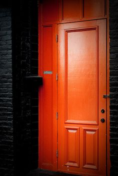 Lately I've been kind of obsessed with orange doors on dark colored buildings