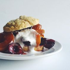 Roasted Stone Fruit with Vanilla Bean On Top Of A Warm Honey Scone with Coconut Whipped Cream // Wife Mama Foodie. Find this #recipe and more on our Scones Feed at https://feedfeed.info/scones #feedfeed