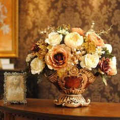 A beautiful and opulent light and warm floral arrangement.