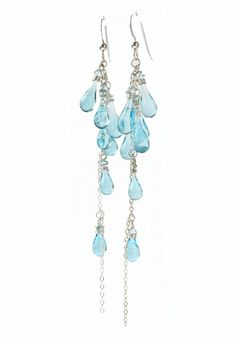 Enchanting glass droplets cluster near the top of these waterfall earrings, trailing down to a dangling tail of glistening silver.