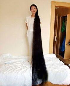 La mujer con el cabello mas largo del mundo.   .