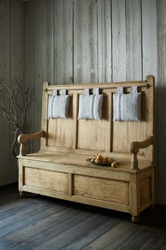 A pine and oak bench with under-seat storage, the Irish Settle from the RLH Collection