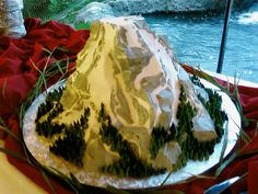 mountain cake add dwarves, gandolf, & a heart dragon topper & it would be perfect!!!!