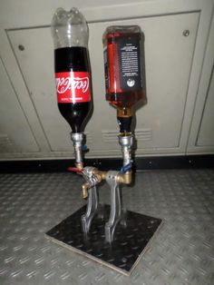 Drinks Dispenser From Recycled Engine Parts Recycling Metal drink dispenser Drinks Dispenser From Recycled Engine Parts Whiskey Dispenser, Alcohol Dispenser, Drink Dispenser, Whisky Spender, Diy Recycling, Steampunk Lamp, Diy Bar, Pipe Furniture, Pipe Lamp