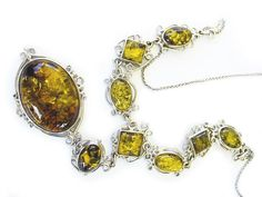 Photo: Amber in 9ct white gold filigree necklace.
