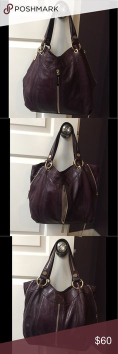Michael Kors deep purple handbag Gorgeous deep purple Michael Kors handbag. Signs of minor wear on the bottom edges as shown. Gold hardware in great condition. The side and front zippers all work. Measurements are photographed and I show it from all angles. Plz let me know if you have any questions! I ship fast! MICHAEL Michael Kors Bags Shoulder Bags
