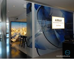 For this Array Sales Office fit out for Mirvac I used a variety to printing techniques: back lit banner vinyl for the light box, printed clear self adhesive vinyl to glass doors and face mounted graphics to acrylic for the signature blue swirl!