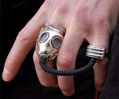 Show off some post apocalyptic fashion with this ominous gas mask ring. The gas mask ring comes complete with a rubber hose and slave ring, and is a perfect fashion accessory to your trench coat, dust goggles, and the multi-purpose axe-shovel. Buy It $412.54 via ManIllusion.no