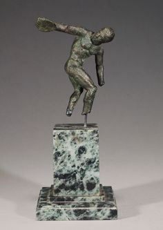 HELLENISTIC BRONZE NUDE DISCOBOLOS    Posed in the iconic stance, about to let loose his discus.    2nd-1st Century BC