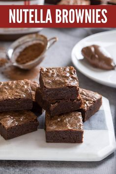 These easy Nutella Brownies are fudgy, gooey and perfectly chocolate-y. They have a delicious chocolate hazelnut flavor that isn't too rich, and a gooey texture with crinkly brownie tops. The best ever Nutella brownie recipe! Nutella Snacks, 3 Ingredient Nutella Brownies, Easy Nutella Brownies, No Bake Brownies, Nutella Recipes, Brownie Recipes, Cake Recipes, Nutella Pancakes, Nutella Cake
