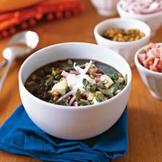 Inspired by his Cuban mother's black bean soup, Chef Douglas Rodriguez of DeLaCosta restaurant in Chicago developed the robust flavor in this recipe for people who didn't have money to spend on meat for stock. Here we use both fresh and dried oregano because each imparts a different flavor to the final dish.