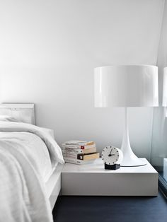 love the white lamp, white bed, white bedding, white walls- almost makes me wish I wasn't such a color junkie...