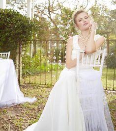 Create a romantic wedding location by adding soft tulle throughout the venue.| DIY Wedding Decor Ideas | Tule Wedding Decor