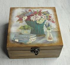Hand decorated wooden tea box. Exterior are meticulously decorated in decoupage, using Eco-friendly materials, and protected with multiple layers of acrylic lacquer. It has four sections for tea bags inside.  Measures: 16 cm x 16 cm (approx 6.3 in x 6.3 in) Measurements for single section for tea bags: 7 x 7 cm, height 7 cm (2.75 in)  A beautiful tea box perfect for a gift to anyone or yourself.  Item is made on clients request so it may be different a little than the one on the picture…