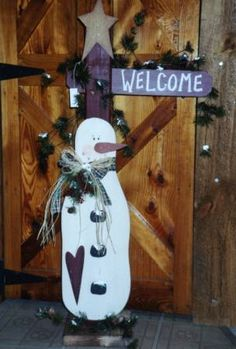 This snowman is attached to the post with a welcome sign. Measures 43 high  $45.00   Wood Ruffle & Lace Original ~ 2006   This item is available throughlocal orders, open house events and craft shows only.