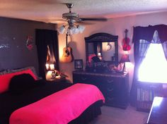 Neon pink and black Master bedroom. Mirrors and curtains above nightstands to make it appear to have windows.