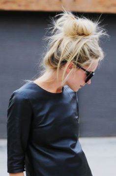 Day-old hair? Turn it into a messy sock bun and secure with bobby pins and light hold hair spray