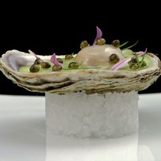 """Daniel Humm's Royal Sterling Caviar """"Vichyssoise"""" of Caraquet Oysters - caviar pearls, oyster gelée with a vichyssoise of potatoes and leeks - all inside an oyster"""