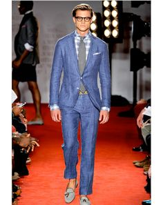 This is how to pull off a casual suit. Get a patterned and light undershirt and dont take yourself too seriously.