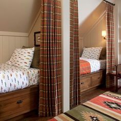 """love how these beds are literally """"built"""" into the attic wall.  Privacy curtain cute as well."""
