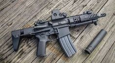 AR15 SBR in 5.56mm with an EOTech and a suppressor.