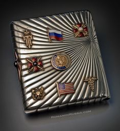 An interesting antique Russian silver cigarette case with gold and enamel appliques from the World War I period.  The case belonged to American Red Cross surgeon General Dr. Philip Newton.