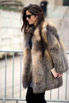 Barbara Martelo in a brown and grey fur coat + black tee + grey skinny jeans + black suede over-the-knee boots
