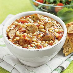 "WHITE-BEAN AND SAUSAGE STEW | This White-Bean and Sausage Stew is an easy weeknight slow cooker meal that your family will love. One online reviewer claims, ""I have made this recipe twice so far and it has been absolutely delicious both times - so simple yet savory and flavorful!"" CLICK FOR RECIPE"