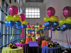 "floating balloon centerpieces. I love how the cut ribbons make it look like the balloons are just ""hovering"" there"