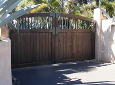 Old World Gate Collection - Wood and Iron Gates - 'Street side view' -- Sederra driveway gates included a powder coated steel support frame. A variety of finishes to choose from, or purchase unfinished.