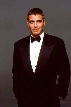 George Clooney as Bruce Wayne.
