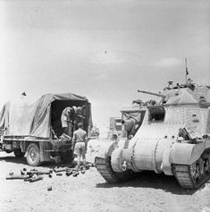 A Grant tank crew loading up with ammunition from a supply truck, 18 June 1942.