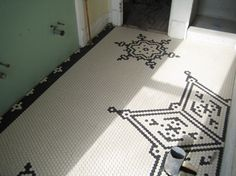 If you're restoring a Victorian bathroom, you might want to check out the custom borders available in small square tiles through American Olean dealers. You just shade in a grid showing the design, pick your colors, and order by the linear foot. They can make you corners to match the design, as well. Delivery is about six weeks, and the tiles come mounted on mesh, ready to grout. I've done three bathrooms with these borders, and it really dresses them up - then you just fill in the center fie...