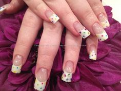 White gel nails with multi coloured polka dot nail art and coloured crystals