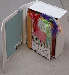 """TRIES TO GO TO ORIGINAL WEBSITE BUT QUICKLY GOES ON TO """"NEOCOUNTER.COM""""      Like the album though, looks like it's made using an empty Cricut Cartridge box! Scraps & things: Mini album"""