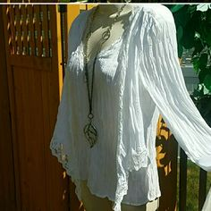 🎋ABSOLUTELY GORGEOUS & ELEGANT! This is a beautiful flowing lacey white shirt. It has beautiful sleeves and also has a lacey vest flowing down the front on each side.  This has the ruffled/crinkled look! SIZE MED. Lots of strech. 100% polyester.. Allison Taylor  Tops Blouses