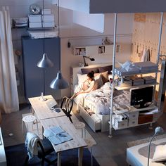 Bedrooms aren't always their own room. We really like this small open space apartment set up that stretches up to the roof with lots of storage. Even the chairs on the wall become shelves for clothes.