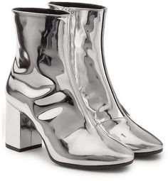 Exhibited above is the Balenciaga Mirror Metallic Leather Ankle Boots. Chic ankle boots from Balenciaga in Silver. Look fashionable wearing these ankle boots by Balenciaga. Thick Heel Boots, Short Heel Boots, Block Heel Ankle Boots, Ankle Booties, Block Heels, Metallic Ankle Boots, Silver Shoes, Metallic Leather, Metallic Style
