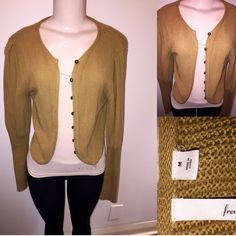 Cropped sweater Frenchie, by Nordstrom• size medium • short/cropped sweater, makes a V shape in the back• button down (but the buttons are only for looks, they do not function) Mustard/Brown family color• worn a few times• Frenchi Sweaters