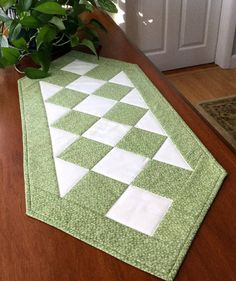 Classic traditional sage green quilted patchwork table runner. So versatile it can be used every day on a table with or without centerpiece and would be very nice for a special occasion on a neutral table cloth.