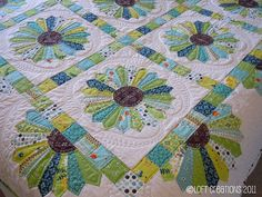 The quilting around the block is beyond my abilities but I love the layout of…