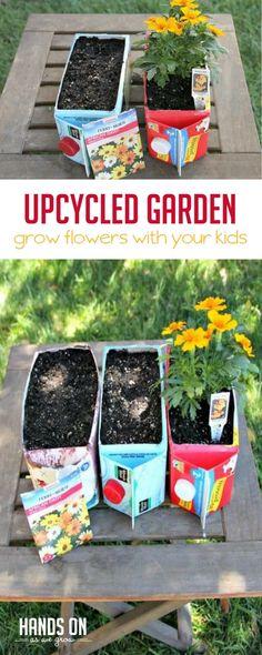 Use recycled juice and milk cartons to make a fun flower garden for kids! via @handsonaswegrow
