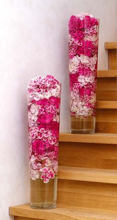 Hydrangea in tall glass vases - so pretty! This would be good for decor around your venue, good for a budget too because normally Hydrangea's are cheap and you can get those tall vases at Home Goods for a decent price! Love the POP of Color.