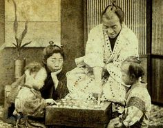 """BAKUMATSU BABIES -- Smiling Father Teaches His Kids the Game of """"Go"""" in Old Japan by Okinawa Soba, via Flickr The above image was taken by RENJO SHIMOOKA, and is probably the first photograph in the history of Japan to show an actual """"toothy"""" smiling face.    This ca.1862-64 shot shows a slice of Japanese life in the years between the arrival of Commodore Perry and his Black Ships in 1853, and the restoration of Emperor Meiji in 1868."""